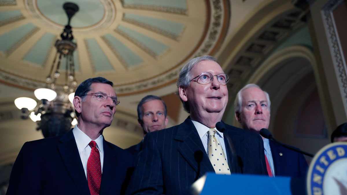 This April 25, 2017, file photo shows Senate Majority Leader Mitch McConnell of Ky., accompanied by, from left, Sen. John Barrasso, R-Wyo., Sen. John Thune, R-S.D., and Senate Majority Whip John Cornyn of Texas on Capitol Hill in Washington.