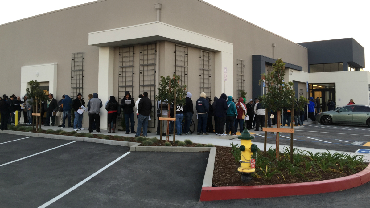 Line of undocumented immigrants waits for the DMV office to open on Senter Road in San Jose to apply for driver's licenses on the first day AB 60 takes effect. Jan. 2, 2014