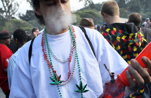 SAN FRANCISCO - APRIL 20:  A marijuana user smokes from a bong during a 420 Day celebration on