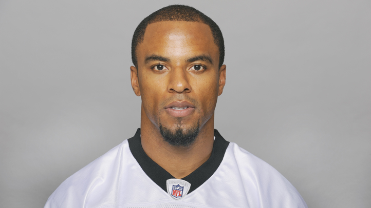 This is a 2009 photo of Darren Sharper of the New Orleans Saints NFL football team. Sharper was arrested on suspicion of rape on Friday, Jan. 17, 2014.