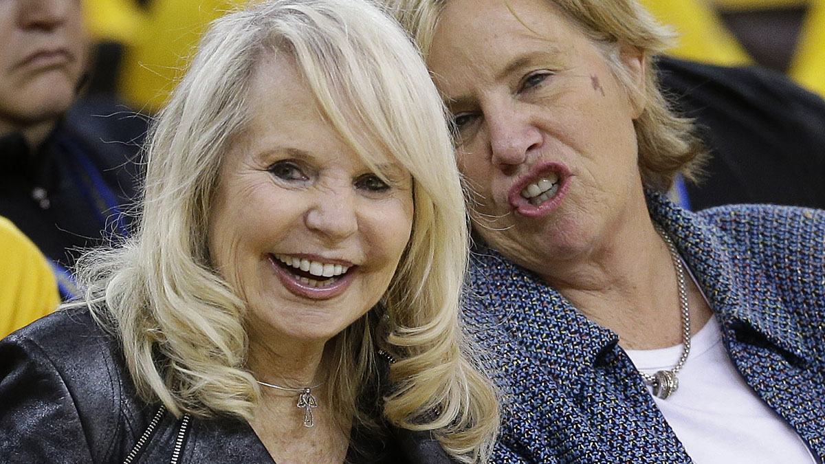 Shelley Sterling, left, wife of Los Angeles Clippers owner Donald Sterling, watches from a court side seat during the second half in Game 4 of an opening-round NBA basketball playoff series between the Clippers and Golden State Warriors.