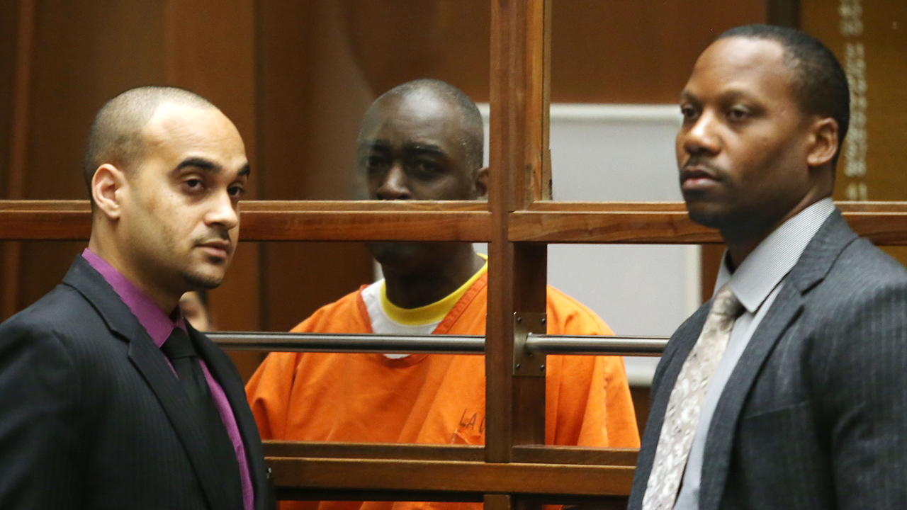 Actor Michael Jace (C) and his attorneys appear in Los Angeles Superior Court on August 1, 2014 in Los Angeles, California. Jace was charged with the May 19 shooting death of his wife April Jace and has pleaded not guilty and waived his rights to a preliminary hearing.