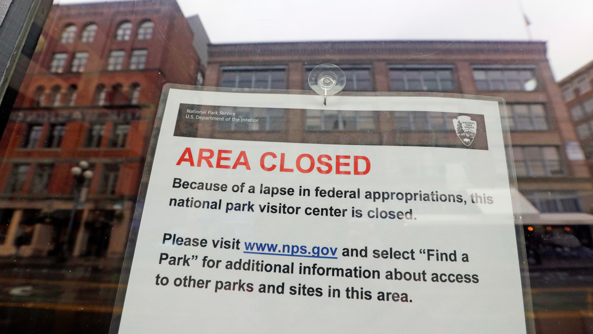 The tiny Klondike Gold Rush National Historical Park in Seattle's historic Pioneer Square neighborhood is posted with a closed sign as part of the federal government shutdown Wednesday, Dec. 26, 2018. The shutdown started Saturday when funding lapsed for nine Cabinet-level departments and dozens of agencies.