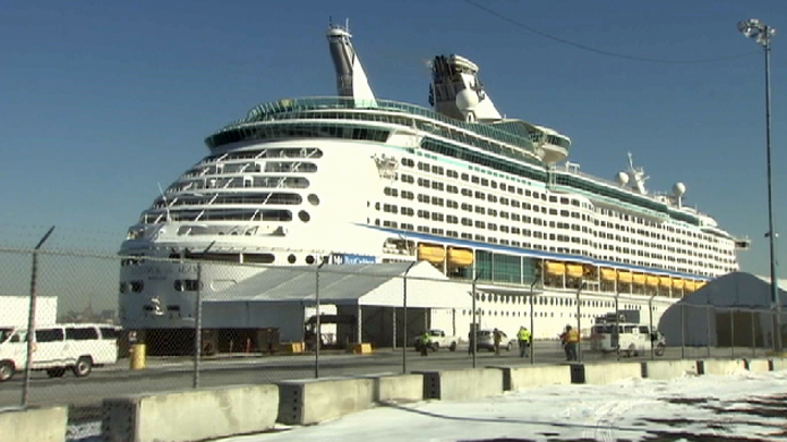 Royal Caribbean's Explorers of the Sea returned to New Jersey on Wednesday. Its trip was cut short by a suspected norovirus outbreak that infected nearly 600 people.