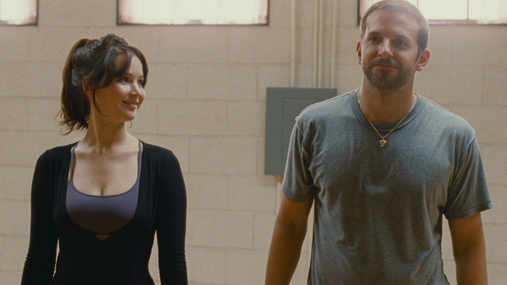 In this photo, provided by The Weinstein Company, Jennifer Lawrence and Bradley Cooper in a scene of the movie