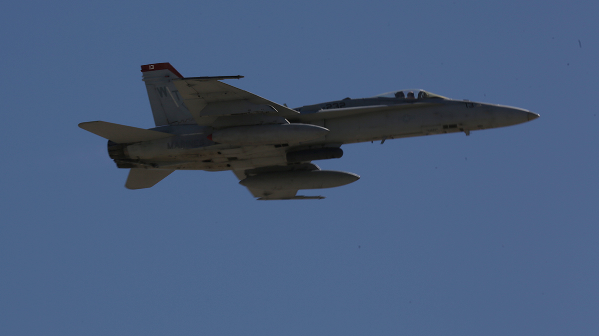 In this Oct. 4, 2014, file photo, a U.S. Marine Corps F/A-18 Hornet flies during the Marine Air Ground Task Force demonstration at Marine Corps Air Station Miramar, San Diego, California.