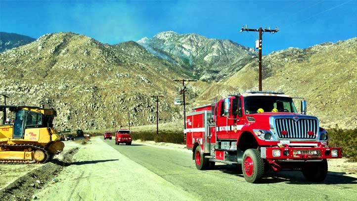 Firefighters stationed in the foothill community of Snow Creek, north of San Jacinto Peak, head into the third day of the battle against the Silver Fire on Friday, Aug. 9, 2013.