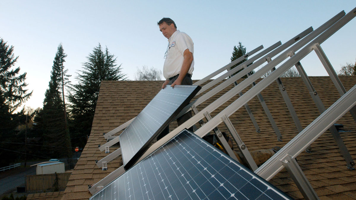 In this November 17, 2005 file photo shows residential solar panels for both electricity production and water heating represent a growing trend for home owners in Oregon seeking energy efficiency.