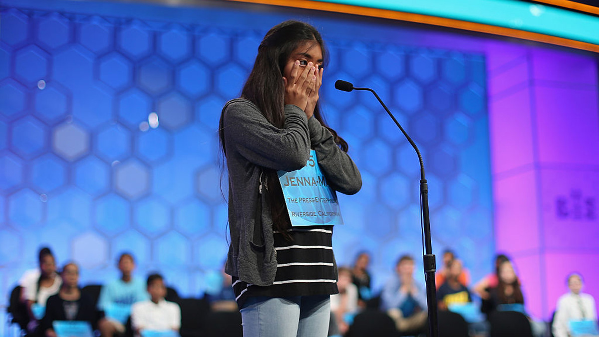 In this file photo, Jenna-May Ingal of Riverside, California, thinks before spelling a word incorrectly during the 88th Scripps National Spelling Bee semifinals at the Gaylord National Convention Center May 28, 2015 in Washington, D.C.