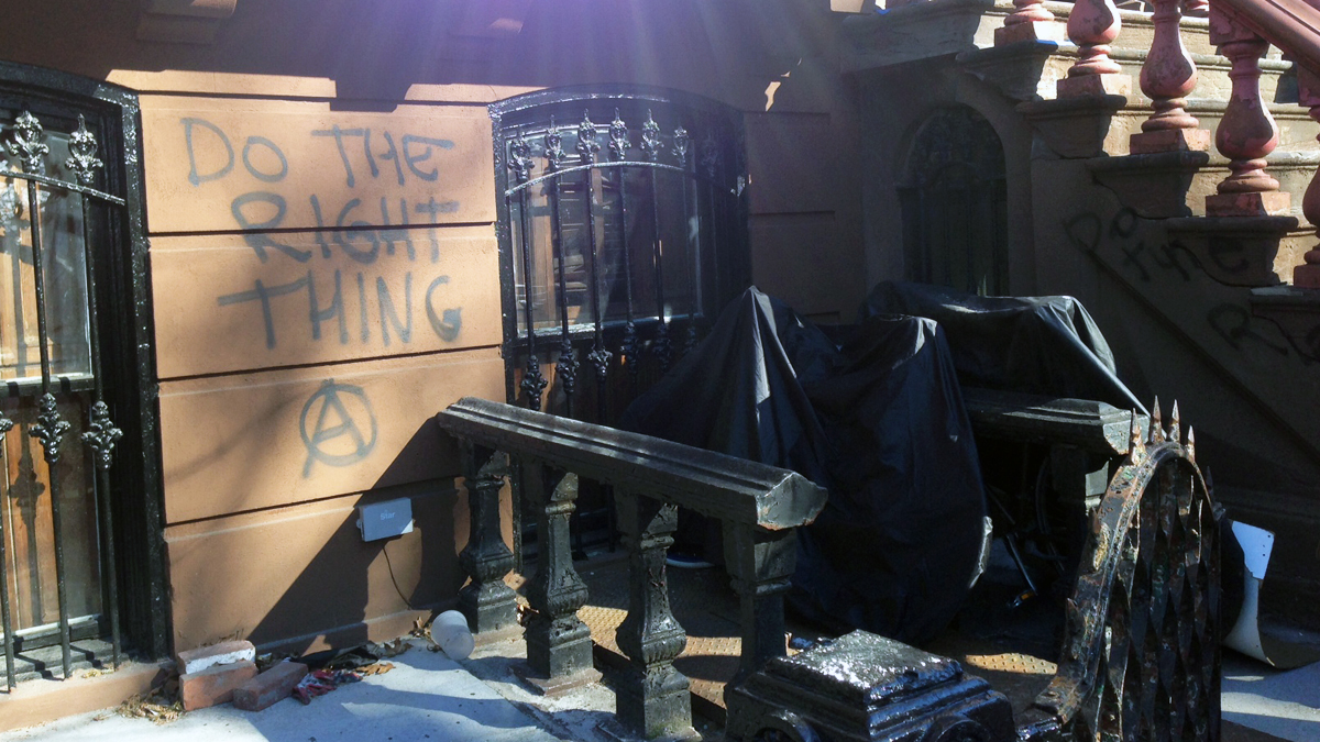 The stoop of the former Washington Park home of Spike Lee was vandalized three days after he delivered a rant against gentrification.  The house next door was graffitied and had a window smashed.