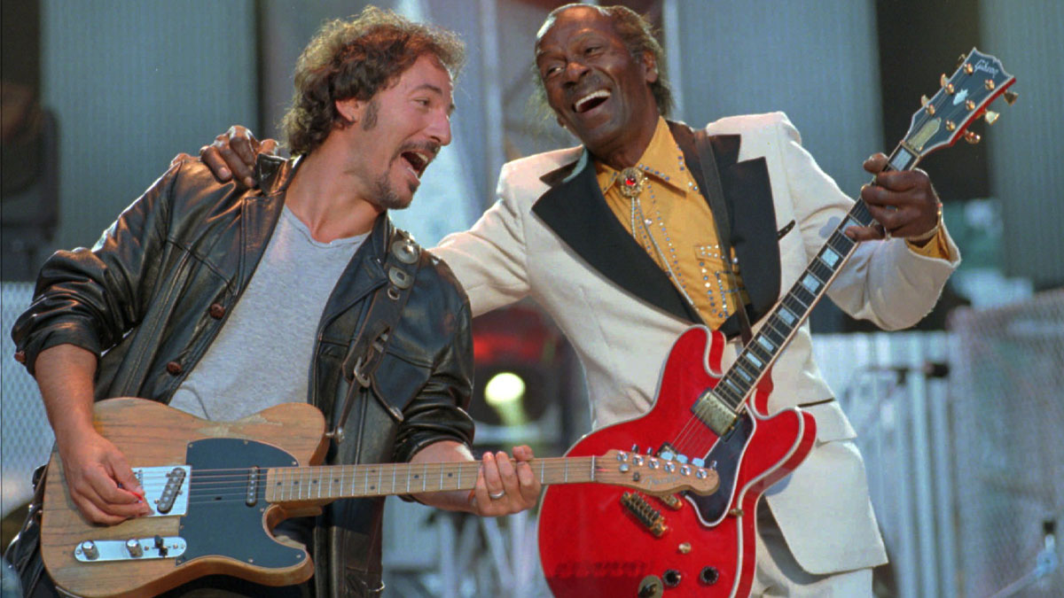 Bruce Springsteen, left , and Chuck Berry laugh during the performance of the Berry hit