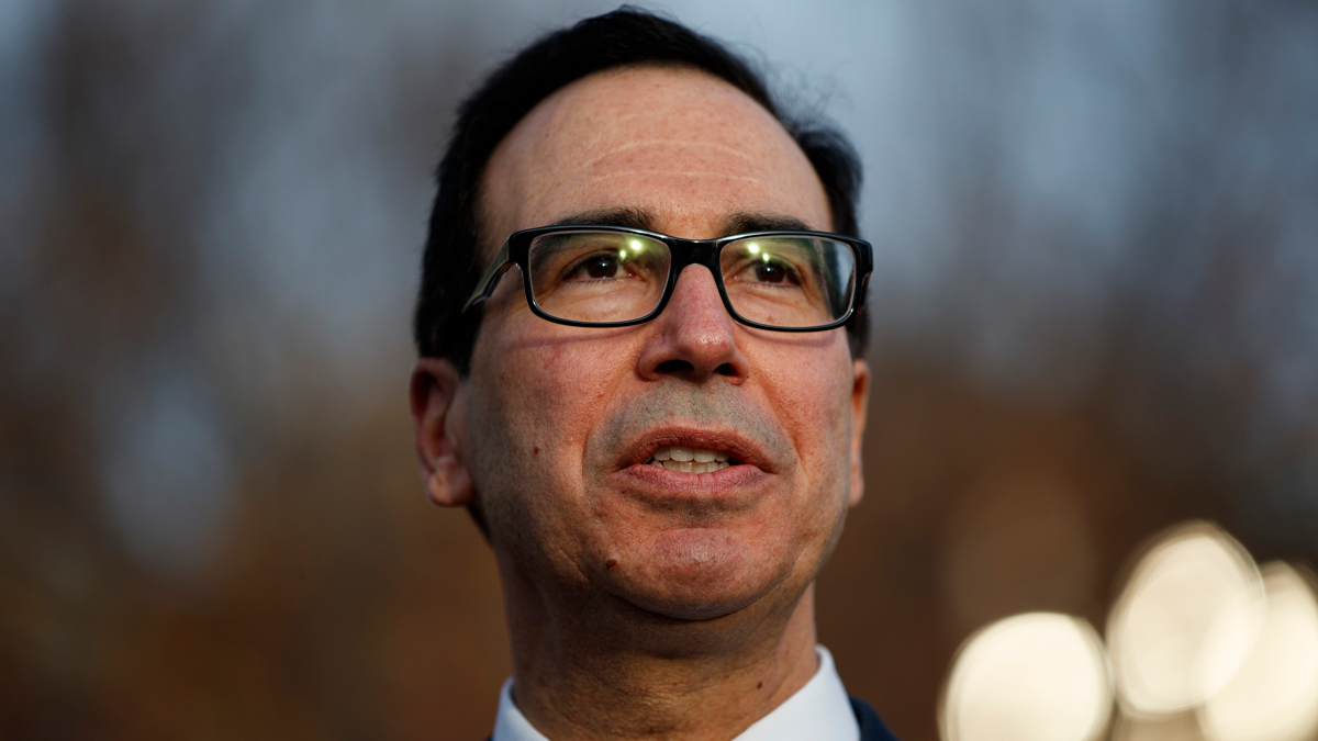 FILE - In this Dec. 3, 2018, file photo, Treasury Secretary Steven Mnuchin talks with reporters at the White House, in Washington. Mnuchin says that the negative market reaction following the Federal Reserve's rate hike was