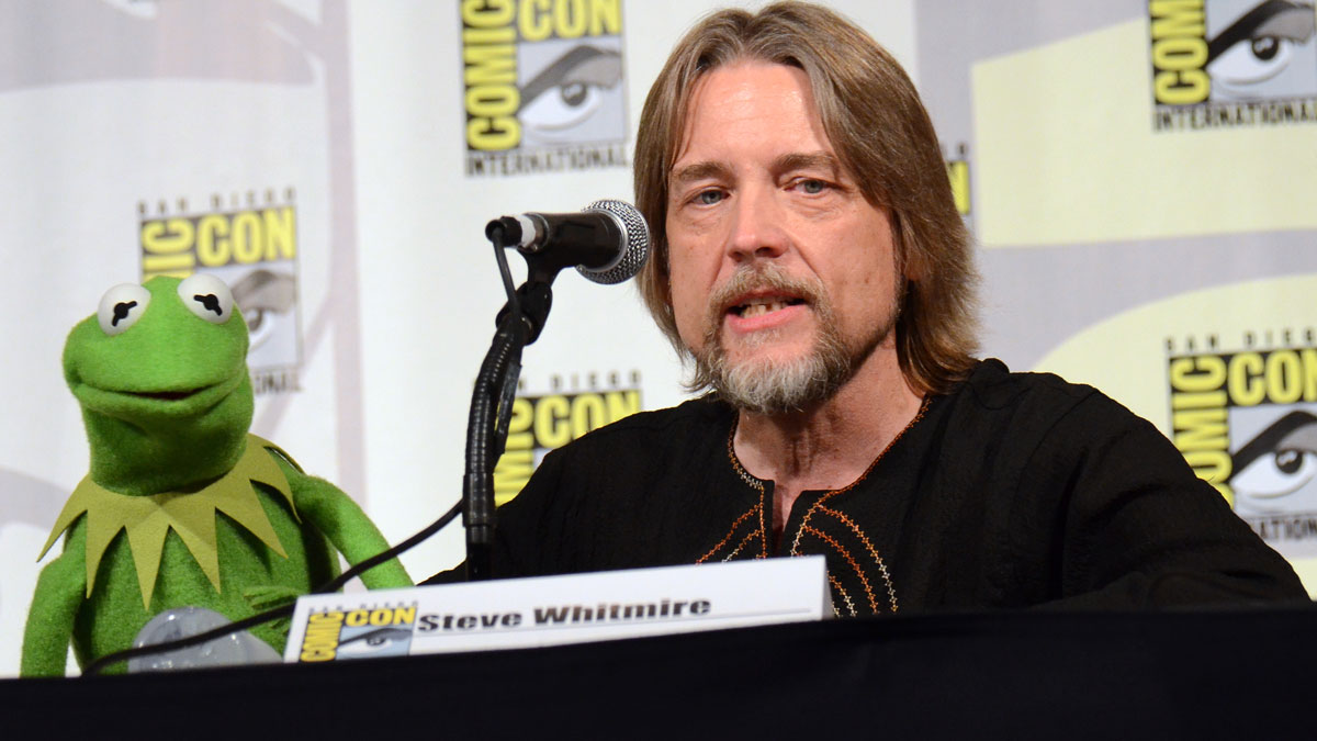 Kermit the Frog, left, and puppeteer Steve Whitmire attend
