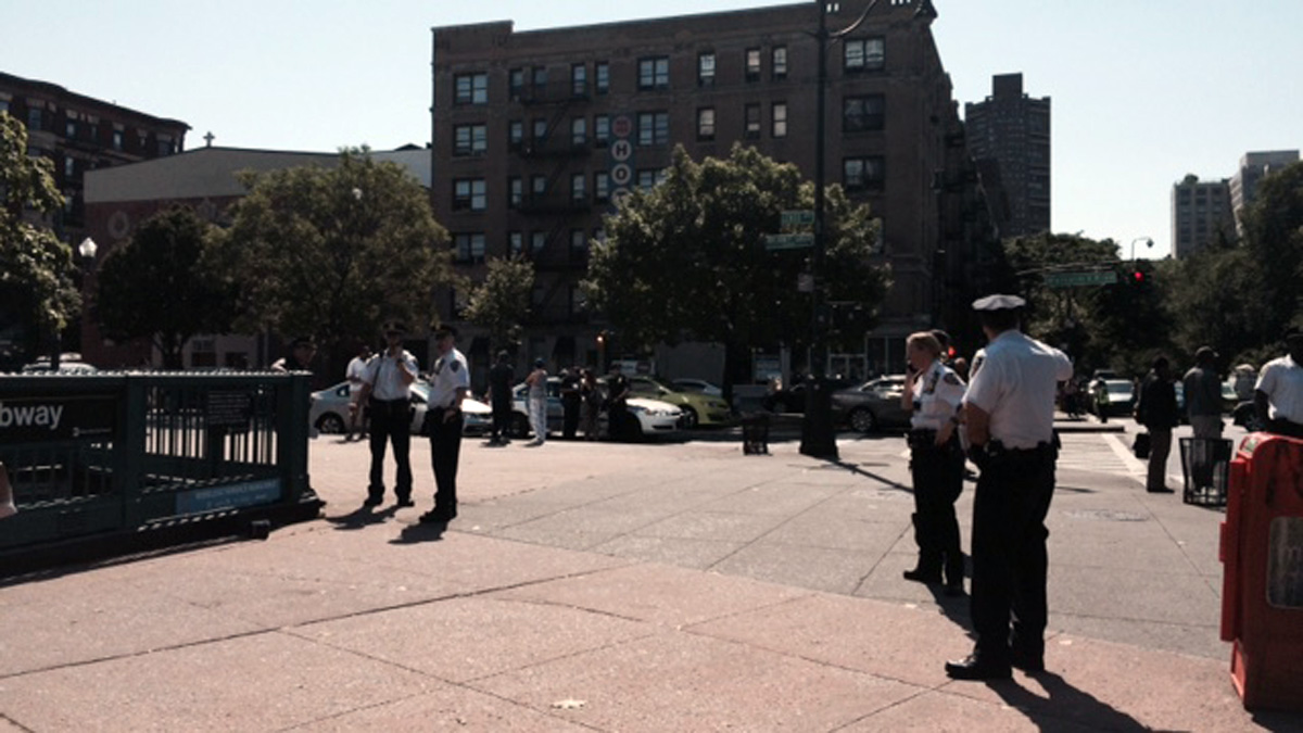 NYPD officers outside the Central Park North -- 110th Street subway station on Tuesday morning.