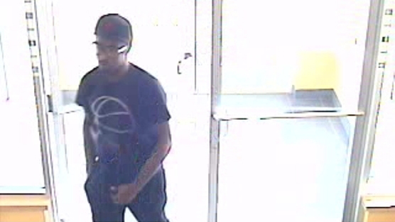Surveillance video of a robbery on Aug. 12, 2015 at the Vibe Credit Union in South Lyon, Michigan. Police believe the suspect to be Brian Randolph.