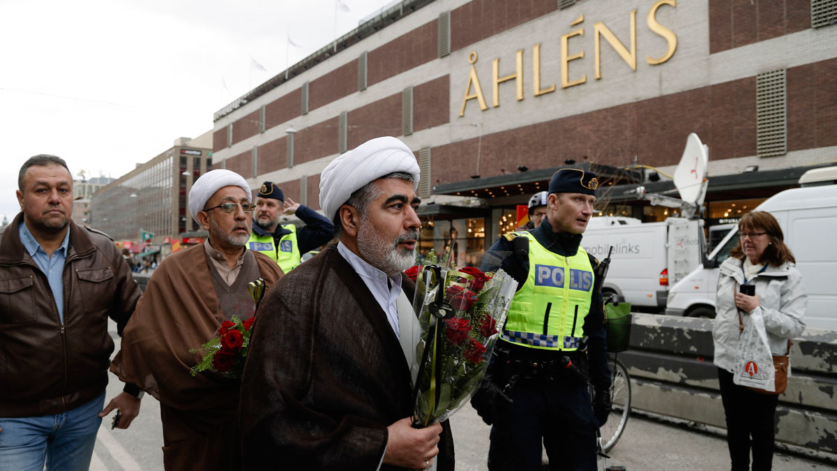FILE - Muslim clerics arrive to lay down flowers near the department store Ahlens following a suspected terror attack in central Stockholm, Sweden, April 8, 2017.