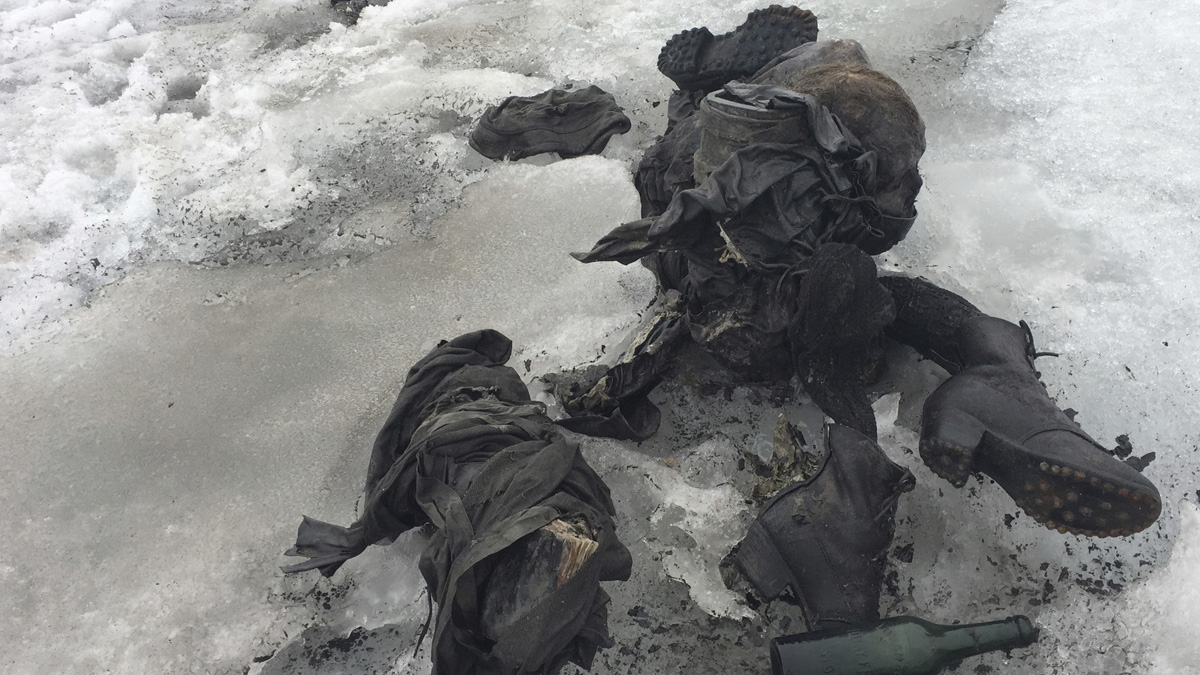This photo released by the Swiss train company 'Glacier 3000' shows the shoes and clothes of two people killed in an accident decades ago. Switzerland.Valais canton police say the bodies were found on the Tsanfleuron glacier Friday July 14, 2017 at an altitude of 2,615 meters (8,580 feet).