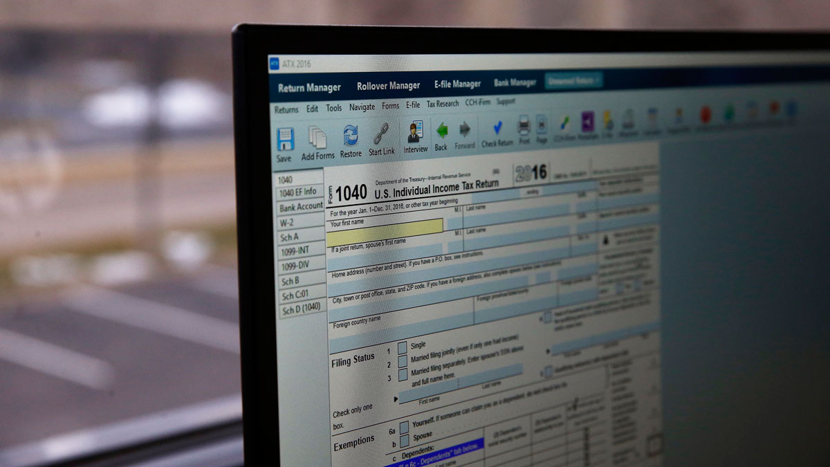 In this Jan. 14, 2017, photo, an online tax form is displayed on a computer at the offices of tax preparation firm Infinite Tax Solutions, in Boulder, Colorado.