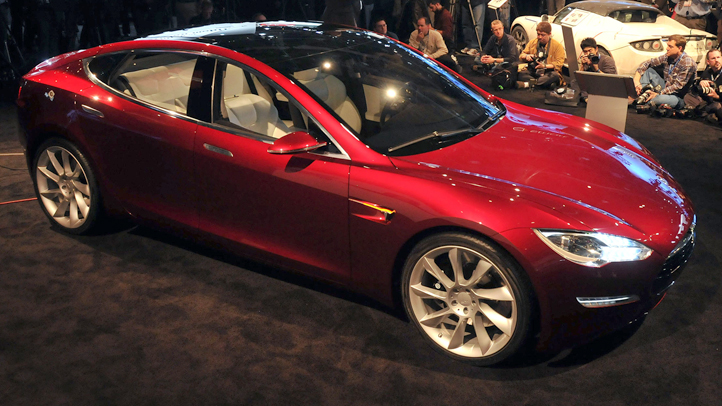 Tesla, the electric car maker whose Model S electric car is pictured, is sharing its technology with competitors.