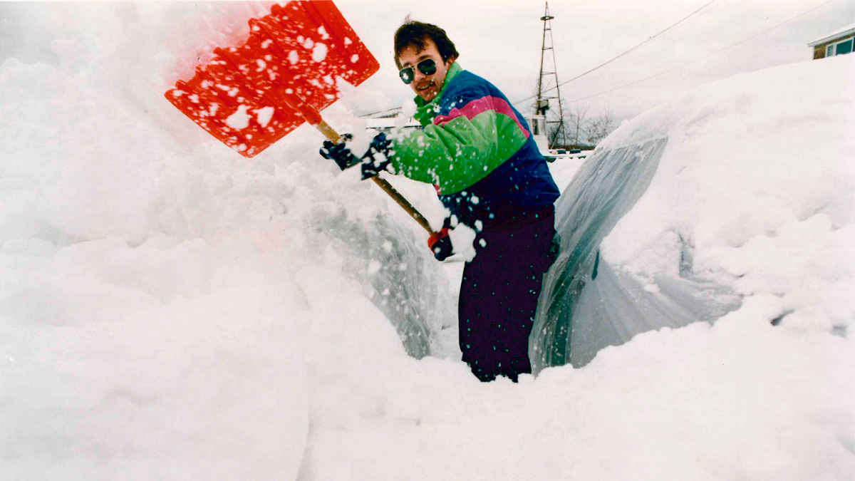 SACO, ME - MARCH 14: Dan Littlefield of Campe Ellis attempts to clear snow from his car Sunday morning, March 14, 1993.