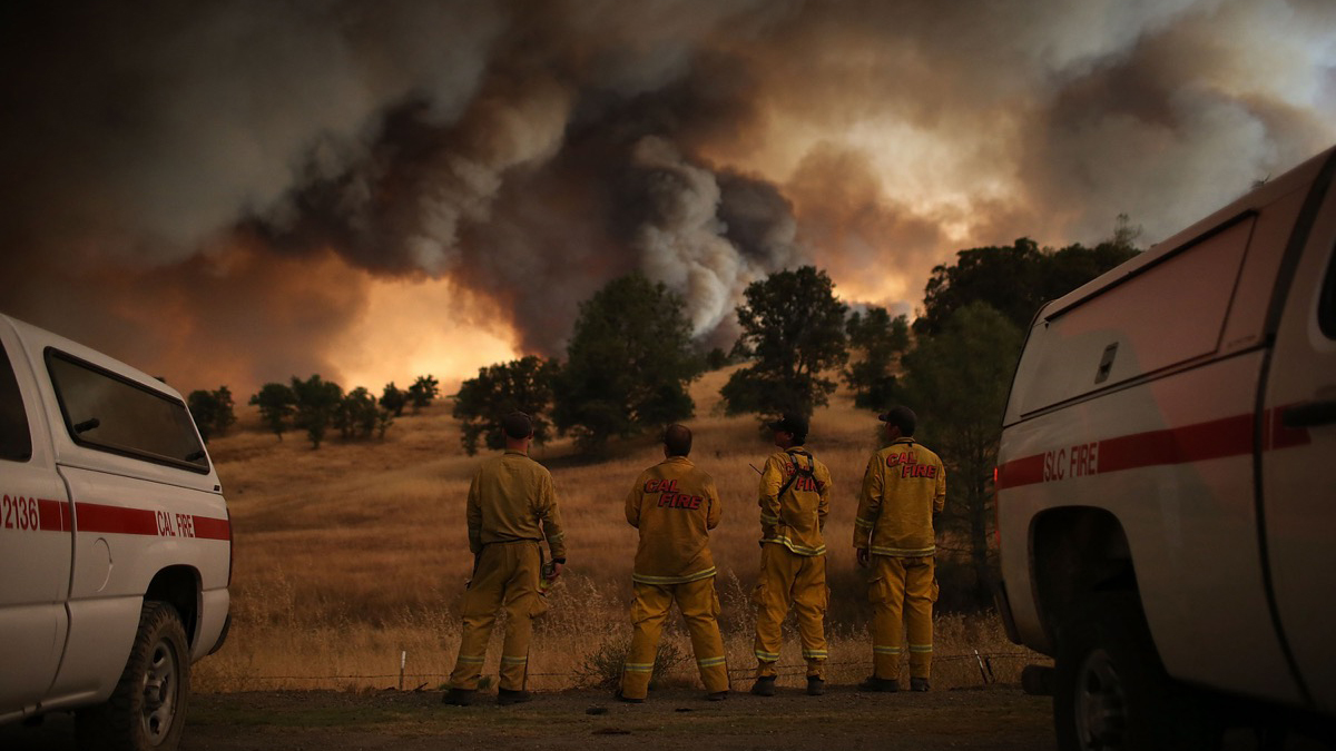 CLEARLAKE, CA - AUGUST 01:  Cal Fire firefighters watch a large plume of smoke as it rises from the Rocky Fire on August 1, 2015 near Clearlake, California. Over 1,900 firefighters are battling the Rocky Fire that burned over 22,000 acres since it started on Wednesday afternoon. The fire is currently five percent contained and has destroyed at least 14 homes.  (Photo by Justin Sullivan/Getty Images)