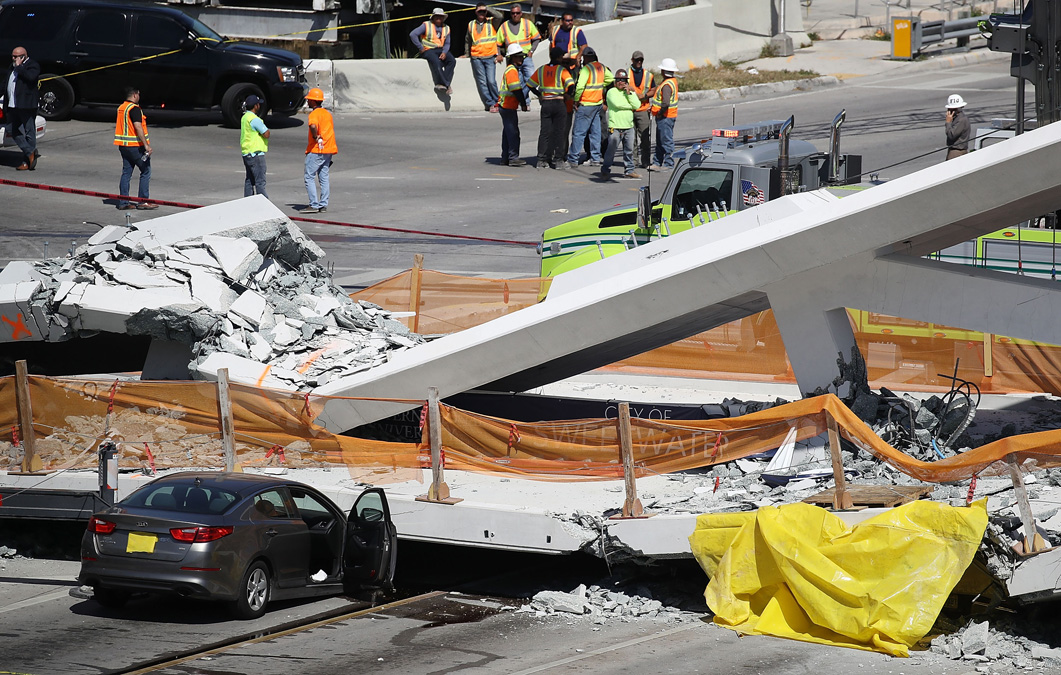 Miami-Dade Fire Rescue Department personel and other rescue units work at the scene where a pedestrian bridge collapsed a few days after it was built over southwest 8th street allowing people to bypass the busy street to reach Florida International University on March 15, 2018 in Miami, Florida. Reports indicate that there are an unknown number of fatalities as a result of the collapse, which crushed at least five cars. (Photo by Joe Raedle/Getty Images)