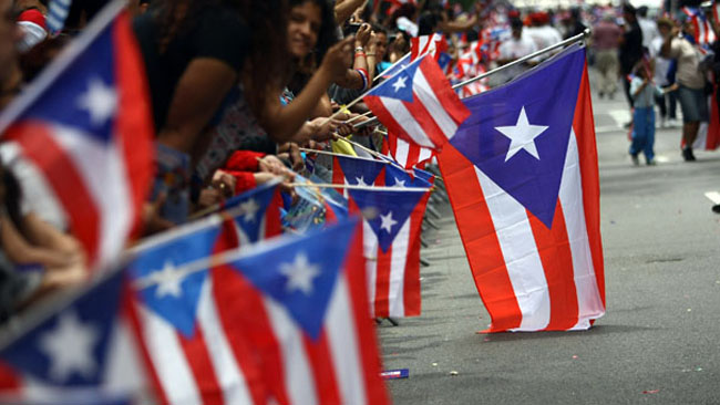 Revelers celebrate during the 2009 Puerto Rican Day Parade on the streets of Manhattan. The Northeast retains the largest share of Puerto Ricans--both mainland and island born--but other regions, especially the South, have become popular destinations