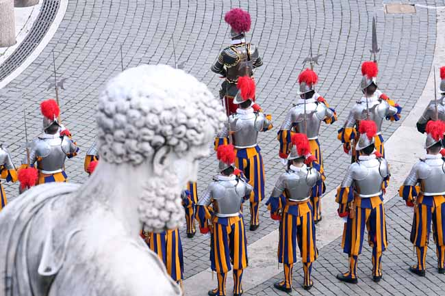 Swiss guards perform ceremonial duties during Holy Easter Mass held by Pope Francis in St. Peter's square on March 31, 2013 in Vatican City, Vatican.