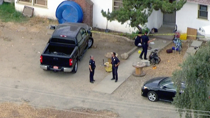 Police investigate the circumstances surrounding a child's death after being in a hot vehicle in Sylmar on Wednesday, July 30, 2014.
