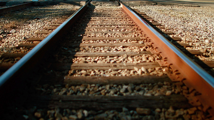 A homeless man fell from a ledge onto train tracks in New Haven while sleeping on Tuesday morning.