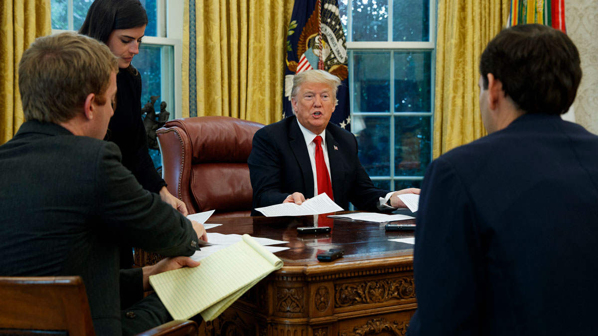 This Oct. 16, 2018, file photo shows President Donald Trump speak during an interview with The Associated Press in the Oval Office of the White House in Washington.