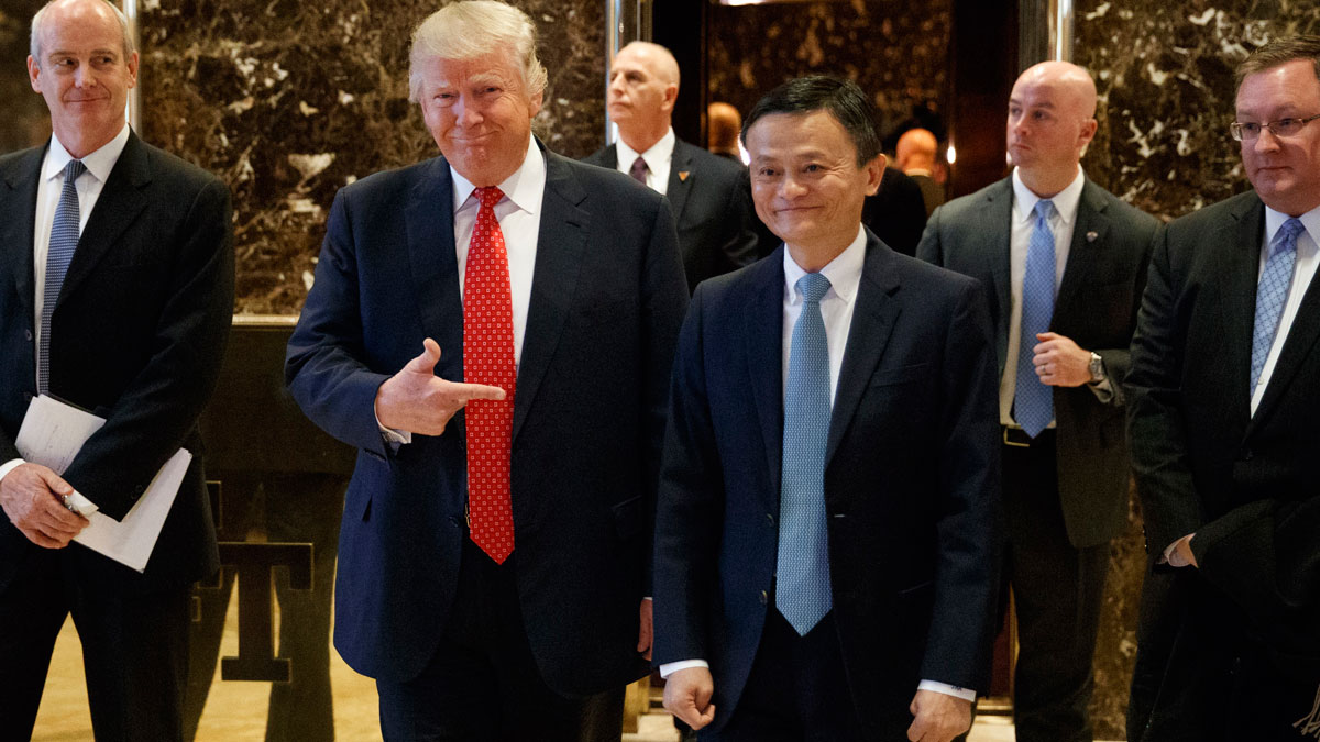 President-elect Donald Trump stands with Alibaba Executive Chairman Jack Ma as they walk to speak with reporters after a meeting at Trump Tower in New York, Monday, Jan. 9, 2017.