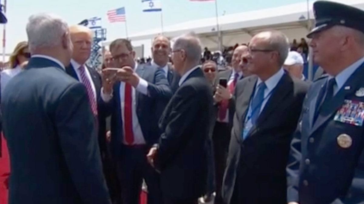 Oren Hazan, an Israeli lawmaker prepares to take a selfie with U.S. President Donald Trump during a welcoming ceremony at Ben-Gurion International Airport, in Tel Aviv, Israel, Monday May 22, 2017. Hazan, a politician in Netanyahu's Likud party with a reputation for inappropriate antics, whipped out a cell phone as Israeli dignitaries greeted Trump and took a selfie with the unamused-looking president. Prime Minister Benjamin Netanyahu attempted, unsuccessfully, to swat Hazan's arm away.