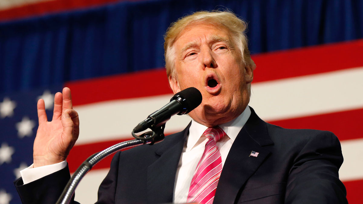 In this Aug. 20, 2016 file photo, Republican presidential candidate Donald Trump speaks at a campaign rally in Fredericksburg, Virginia. At a fundraiser in downtown Austin, Trump was standing next to Perry when he was asked about the Texan's chance to unseat his state's junior senator.