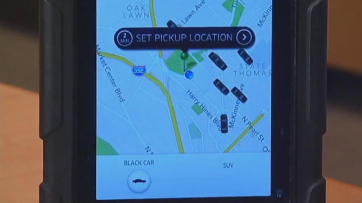 File image of the Uber app. The ride-hailing mogul based in San Francisco reached 2 billion rides.