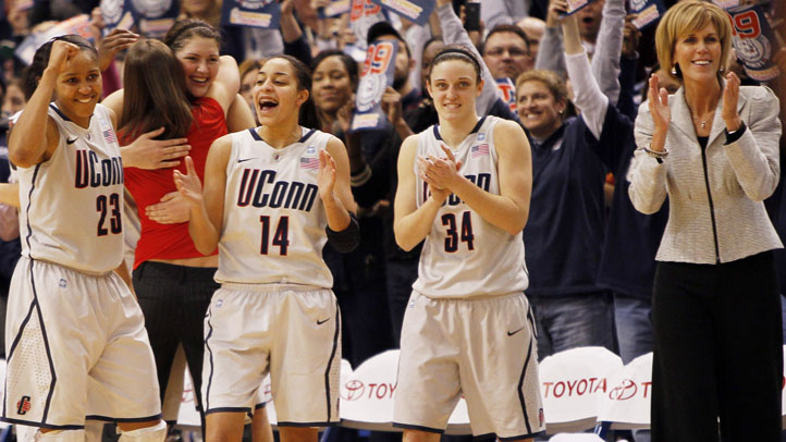 HARTFORD, CT - DECEMBER 21:  Maya Moore #23, Bria Hartley #14, Kelly Faris #34, and assistant coach Chris Dailey of the Connecticut celebrate in the final minutes of a win over Florida State on December 21, 2010 in Hartford, Connecticut.  Connecticut set a record with 89 straight wins without a defeat. (Photo by Jim Rogash/Getty Images)
