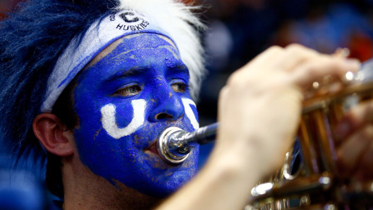A Connecticut Huskies band member plays during the third round of the 2014 NCAA Men's Basketball Tournament against the Villanova Wildcats at the First Niagara Center on March 22, 2014 in Buffalo, New York.