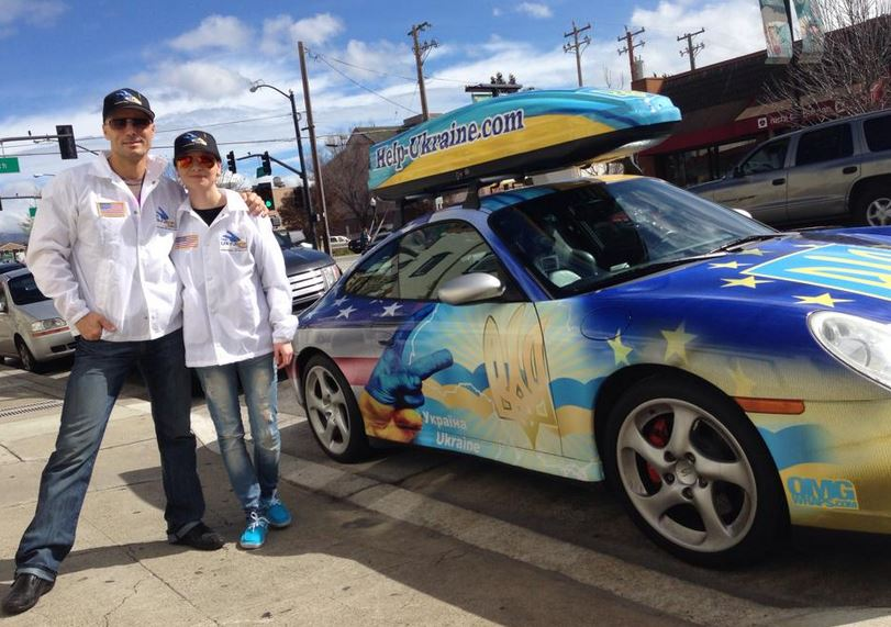 Viktor Kee, left, stands with a friend next to his car. Kee is embarking on a road trip across the U.S. to raise funds for the crisis in Ukraine.