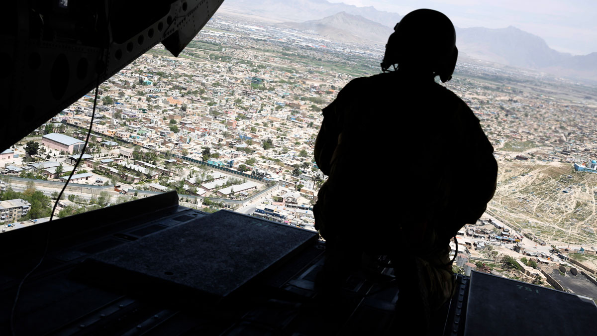 In this April 24, 2017 file photo, a U.S. soldier mans a gun at the back gate aboard the helicopter in Kabul, Afghanistan.