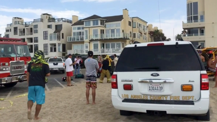 Eight beachgoers were taken to the hospital after a lightning strike in Venice on Sunday, July 27, 2014. One of the victims, a 20-year-old man, later died at the hospital.
