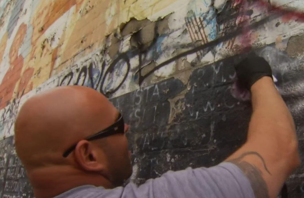 Veterans began showing up in droves to volunteer to help clean a vandalized Vietnam mural ahead of Memorial Day weekend on Sunday, May 29, 2016.