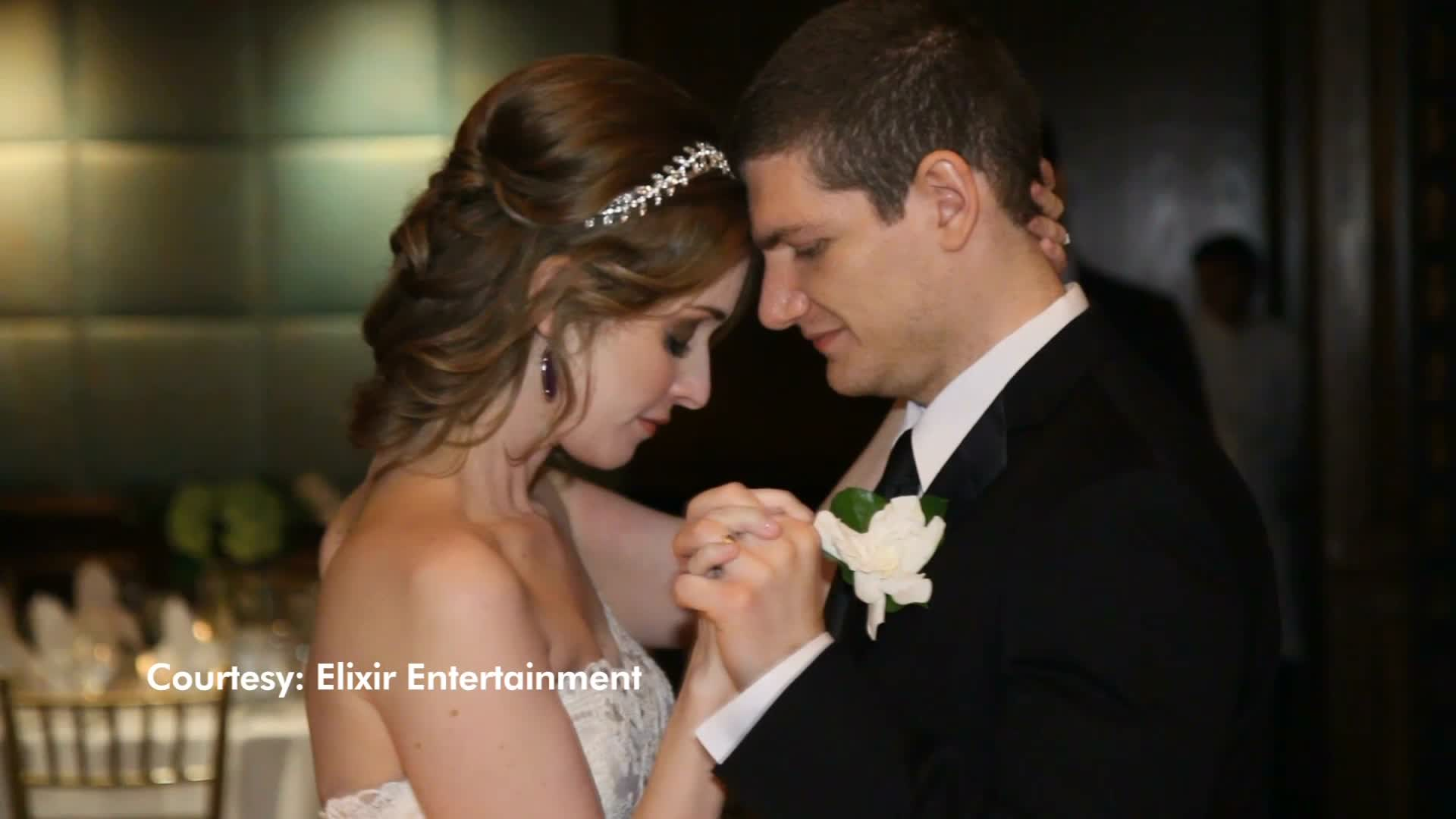 """Dallas newlyweds Andrew and Neely Moldovan claim that their wedding photographer is holding their pictures hostage unless they pay an extra fee for a """"cover"""" for their photo album – even though they already paid for the book itself."""