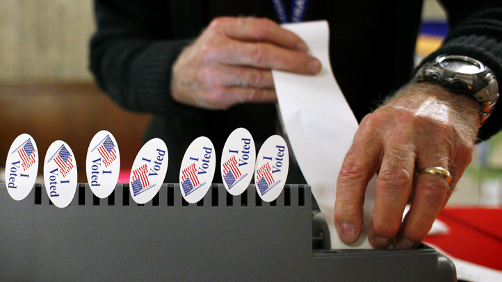 AUSTIN, TX -  FEBRUARY  19:  A pollster loads paper in a primary registration machine at the Travis County Courthouse February 19, 2008 in Austin, Texas. Early voting begins today across Texas ahead of the presidential primaries taking place on Tuesday, March 4, 2008. (Photo by Ben Sklar/Getty Images)