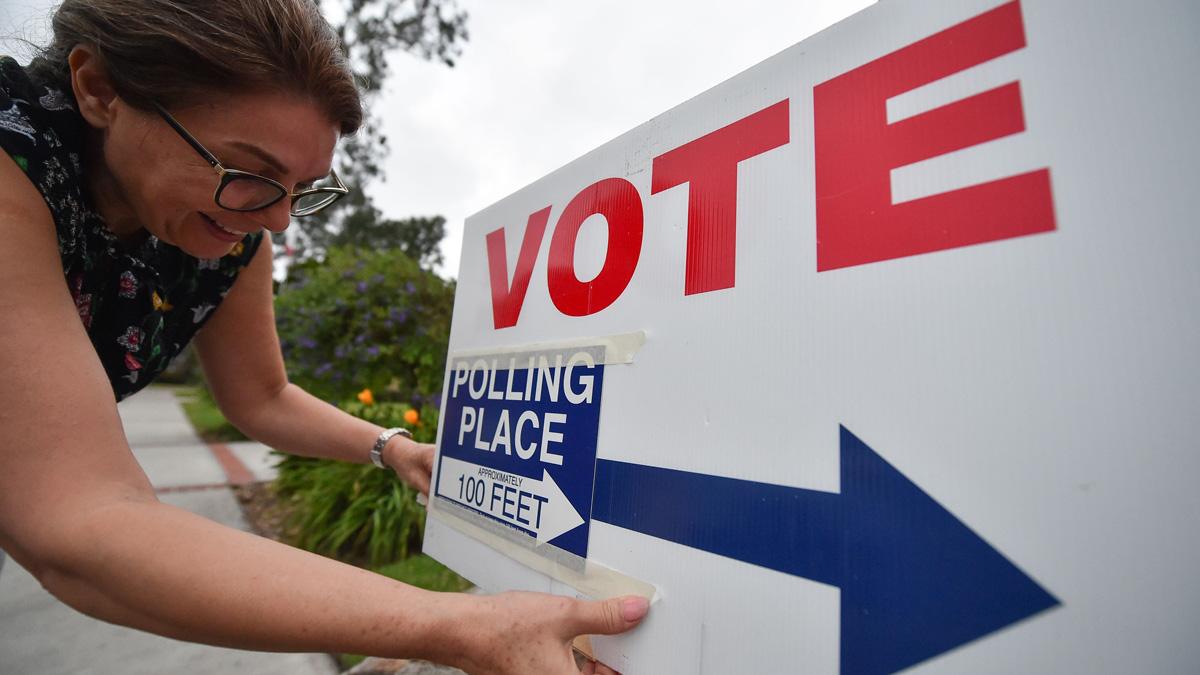 This file photo shows a poll worker in Laguna Beach, California, on Nov. 6, 2018.