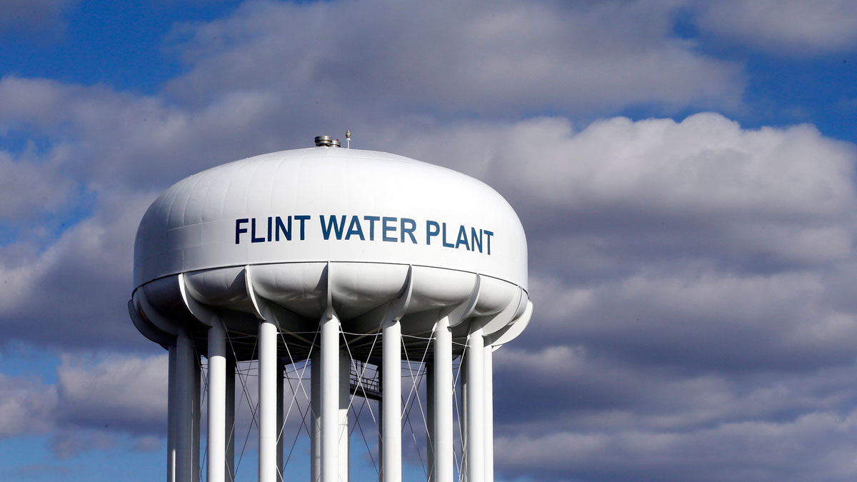 In this March 21, 2016 file photo, the Flint Water Plant water tower is seen in Flint, Mich. Michigan environmental officials announced Tuesday, Jan. 24, 2017, that Flint's water system no longer has levels of lead exceeding the federal limit. The finding by the Department of Environmental Quality is good news for a city whose 100,000 residents have grappled with the man-made water crisis since 2014.