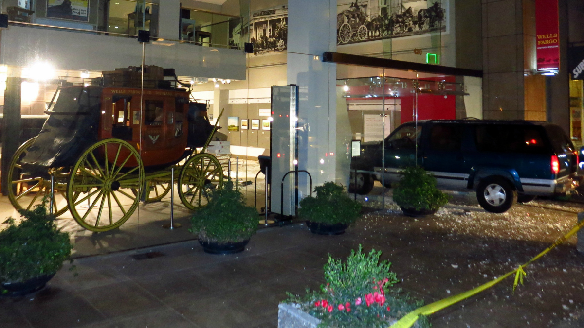 An SUV sits inside the Wells Fargo Museum in San Francisco after police said a trio of armed suspects rammed it into the building and stole gold nuggets. Jan. 27, 2015