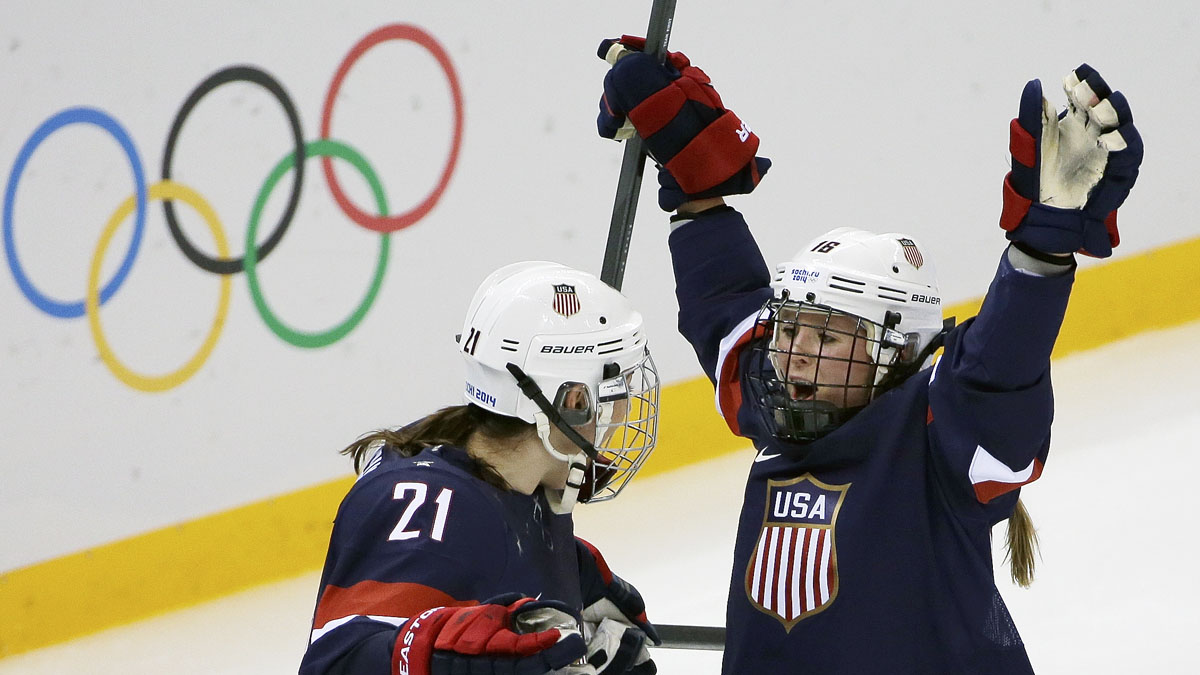 Kelli Stack of the Untied States celebrates her goal with teammate Hilary Knight during the second period of the 2014 Winter Olympics women's ice hockey game against Finland at Shayba Arena, Saturday, Feb. 8, 2014, in Sochi, Russia. (AP Photo/David J. Phillip )