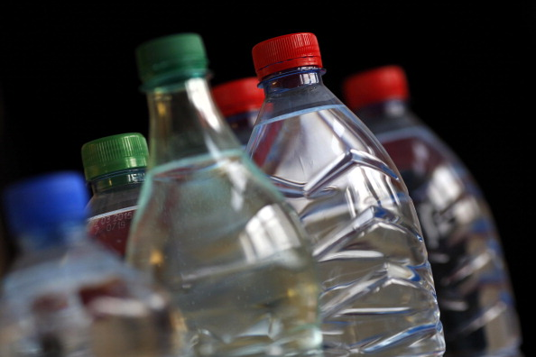 Plastic water bottles are seen in this file photo.    (Photo credit should read THOMAS COEX/AFP/Getty Images)