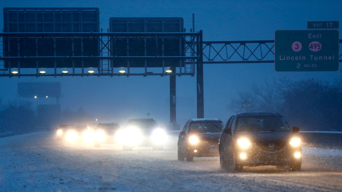 Vehicles commute under snowfall northbound on the New Jersey Turnpike, Saturday, Dec. 17, 2016, in Ridgefield, N.J.